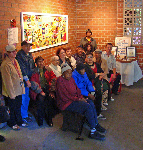 Group portrait of participants at the ribbon cutting ceremony who created the ceramic tile mural at Frederick Douglass Senior Center.