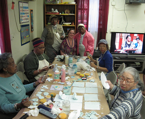 Group glazing tiles at Frederick Douglass Senior Center