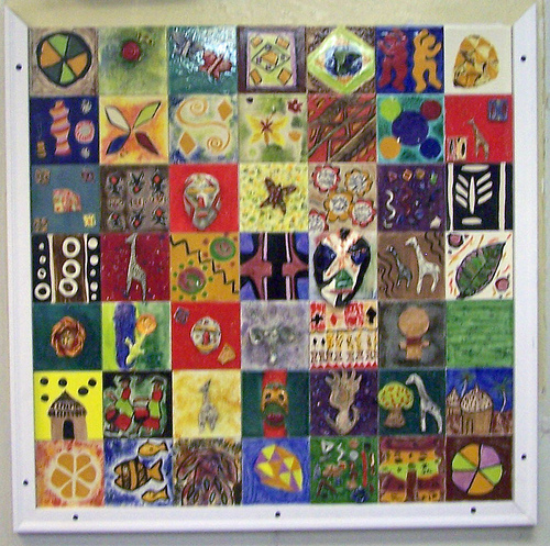 African textiles worn by the participants and adorning the walls of the center inspired this mural.