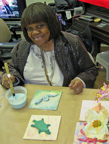 Odessa working on Glazing tiles for the Frederick Douglass Mural, installed at the NY Aquarium